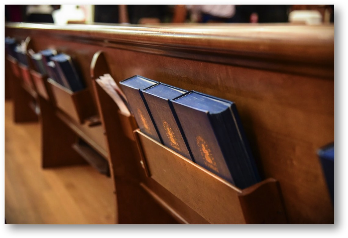 Pew with hymnals